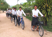 The FLOW children receive care, school supplies, school uniform, and bicycle to go to school.
